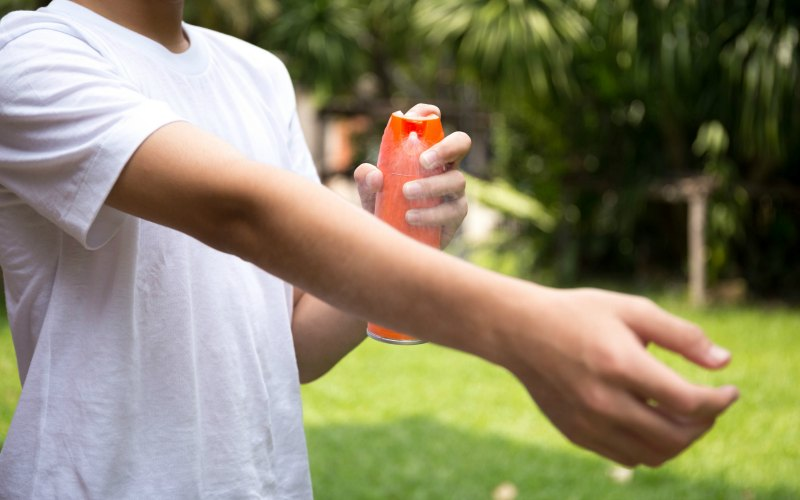 applying bug spray