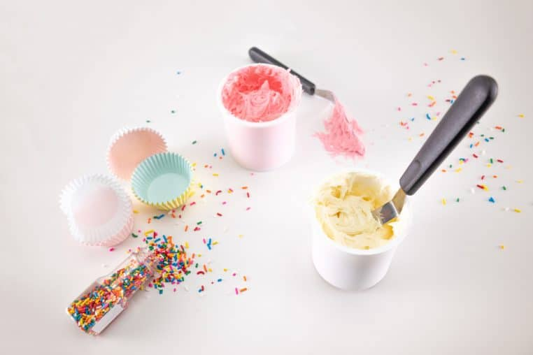cupcake papers with frosting and sprinkles