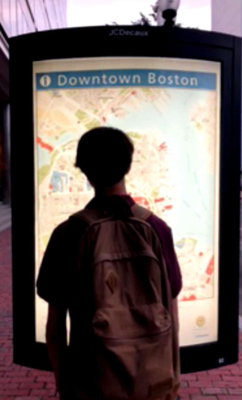 boy reading Boston subway map