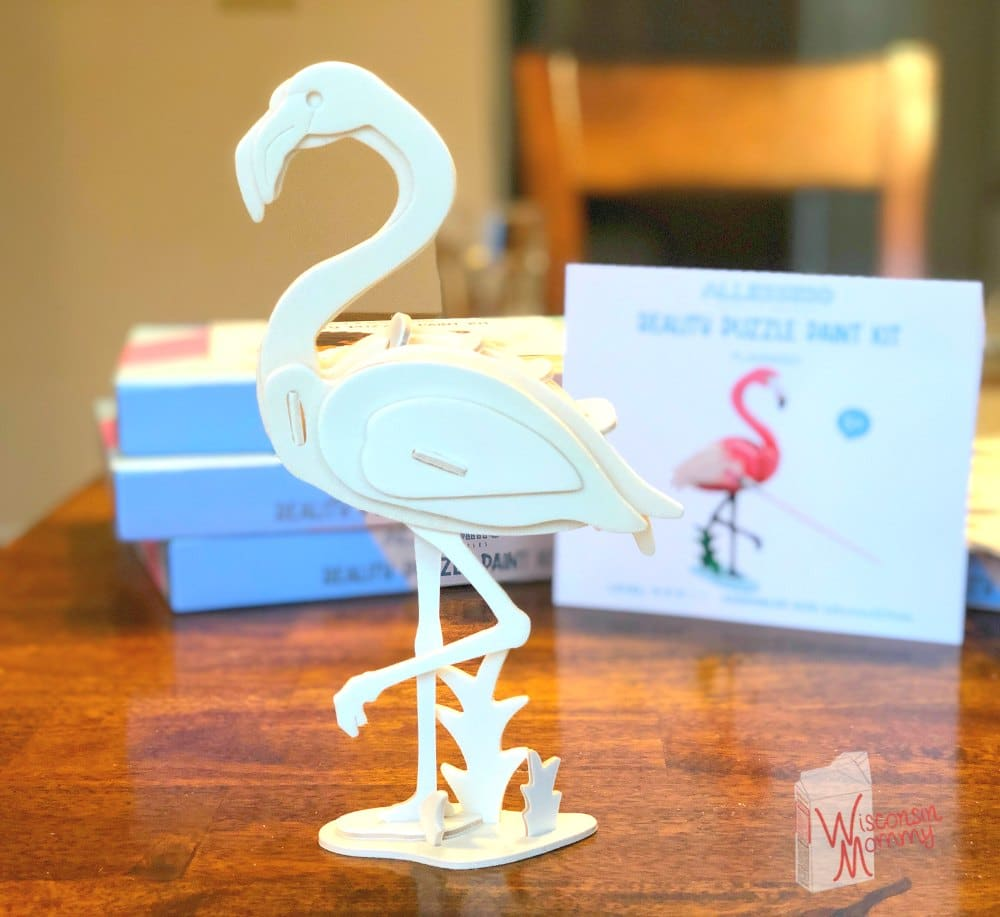 completed wooden flamingo puzzle on table