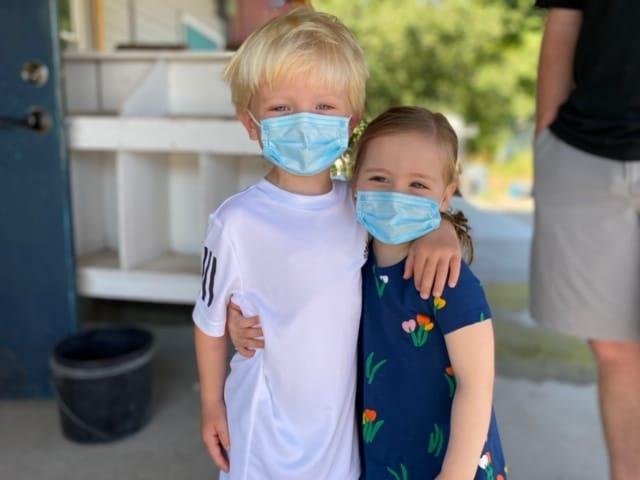 two children wearing masks