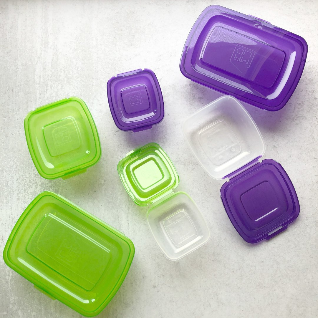 six containers with attached lids