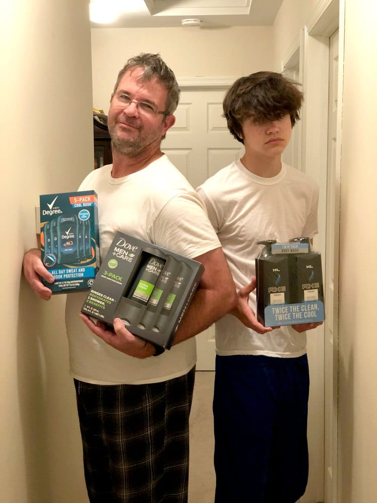 two men holding bath products from Dove and AXE