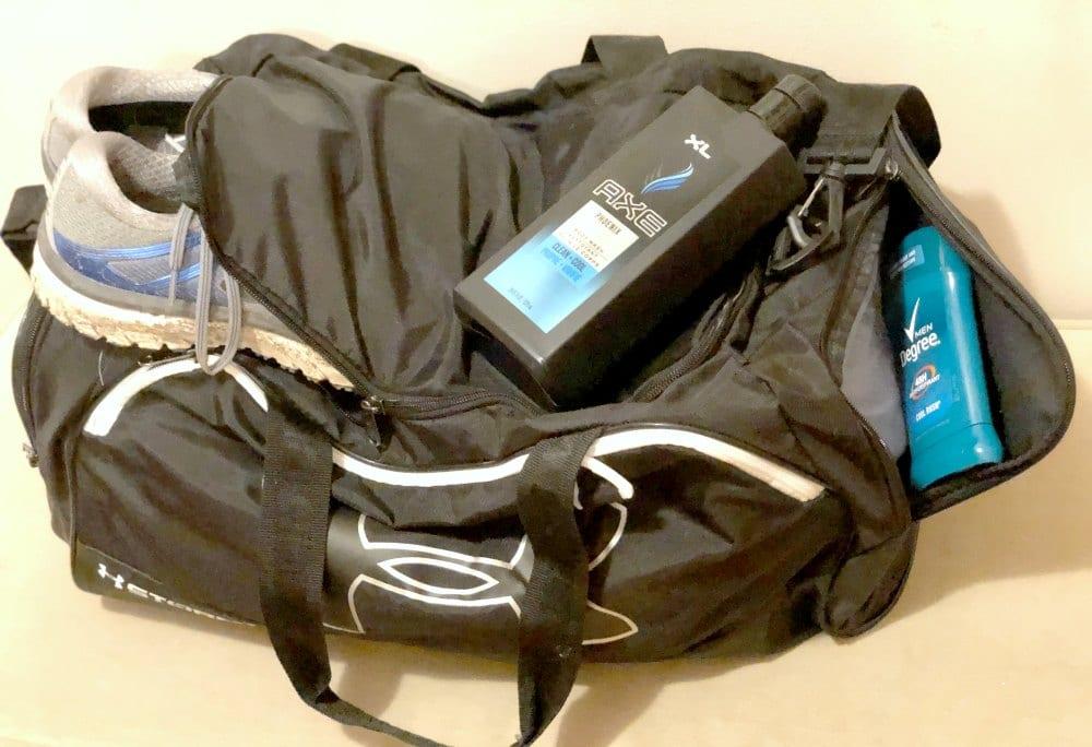 a black gym bag with shower gel bottle on top