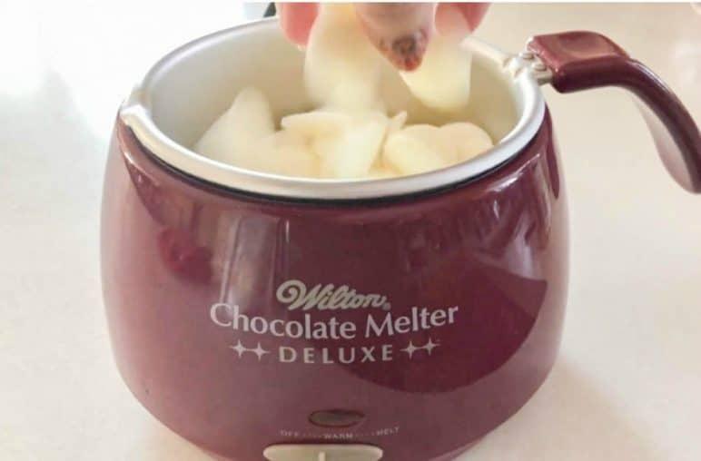 white chocolate melting in melting pot