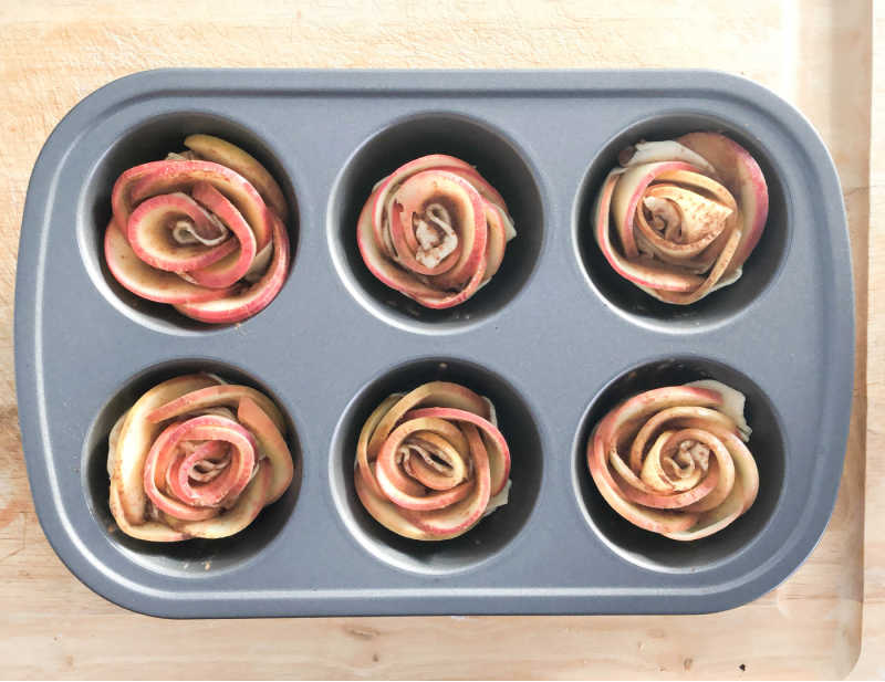 apple blossoms in muffin tin