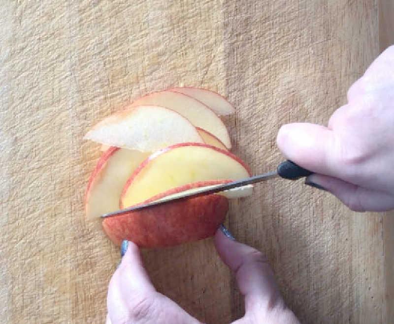 knife slicing apple